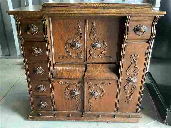 Singer sewing machine with handcarved oak cabinet