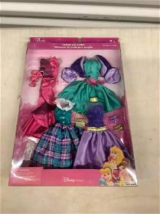 Four Disney Princess outfits mint in box