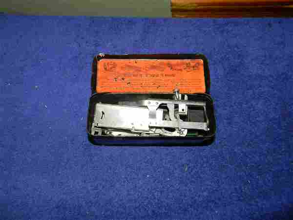 Tin of Singer Sewing Machine Attachments