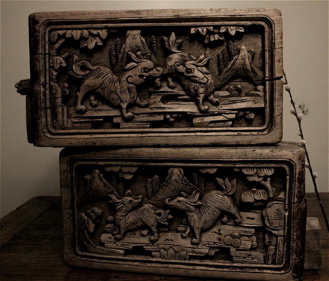 Chinese pair of wood carved architectural blocks