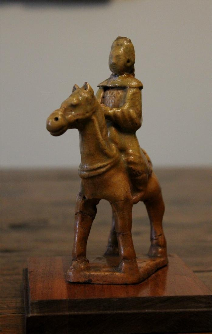 chinese yellow porcelain figure on horse