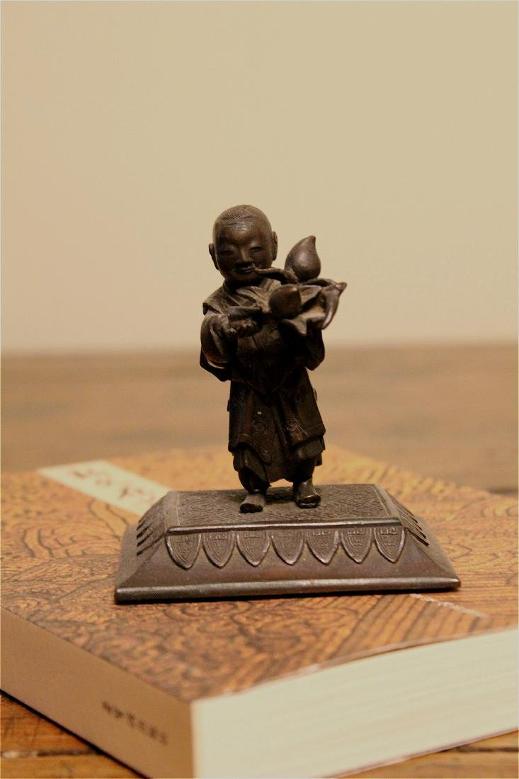 chinese bronze boy holding peaches