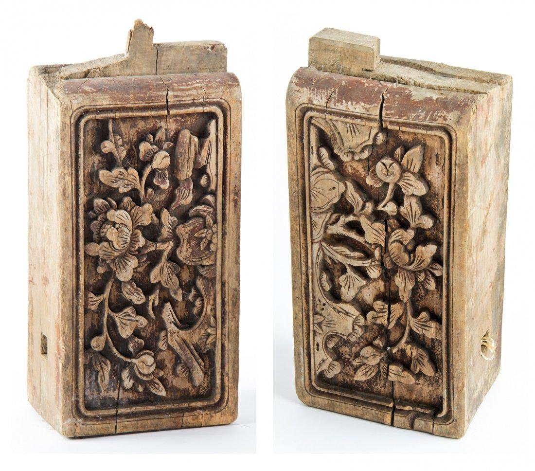 pair of wood carved pieces