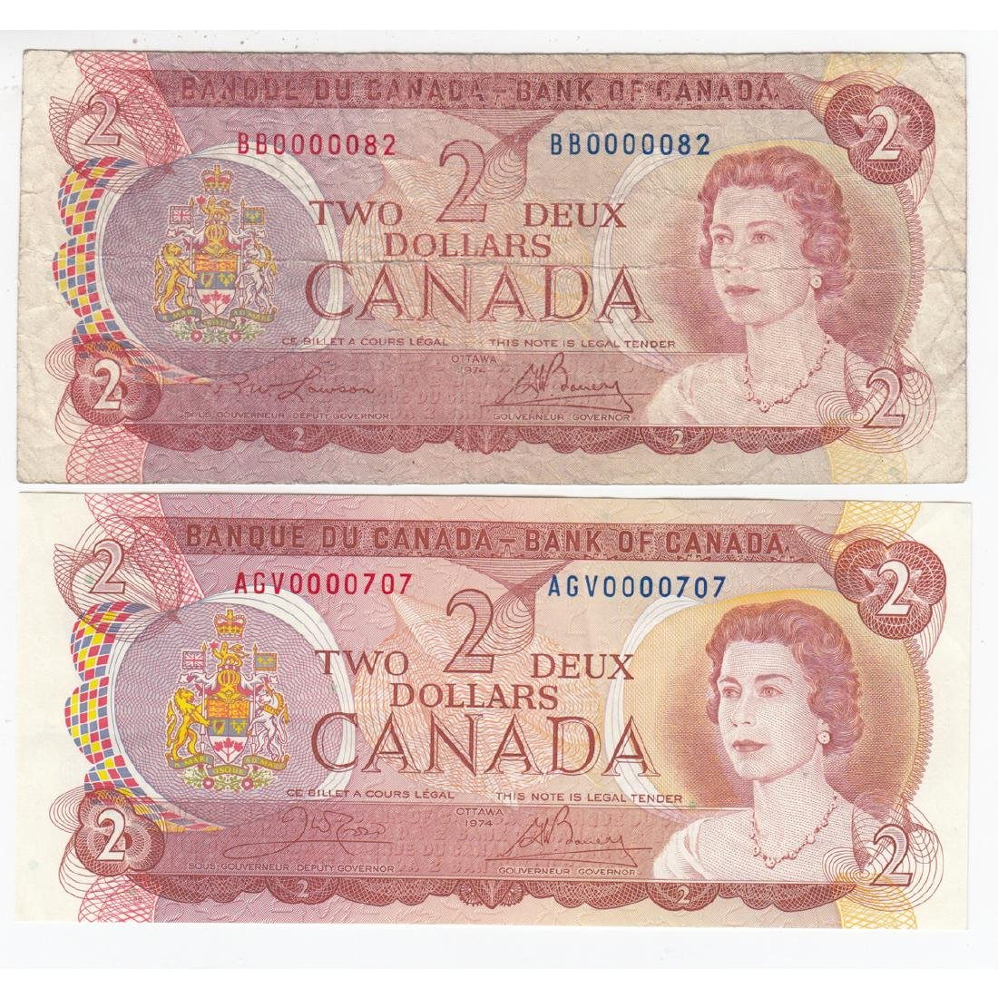 Pair of low serial number $2.00 notes in circulated