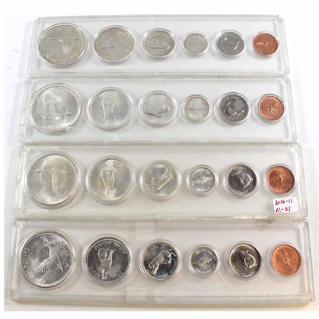4x 1967 Canada 6-Coin Year Set in hard plastic holder.