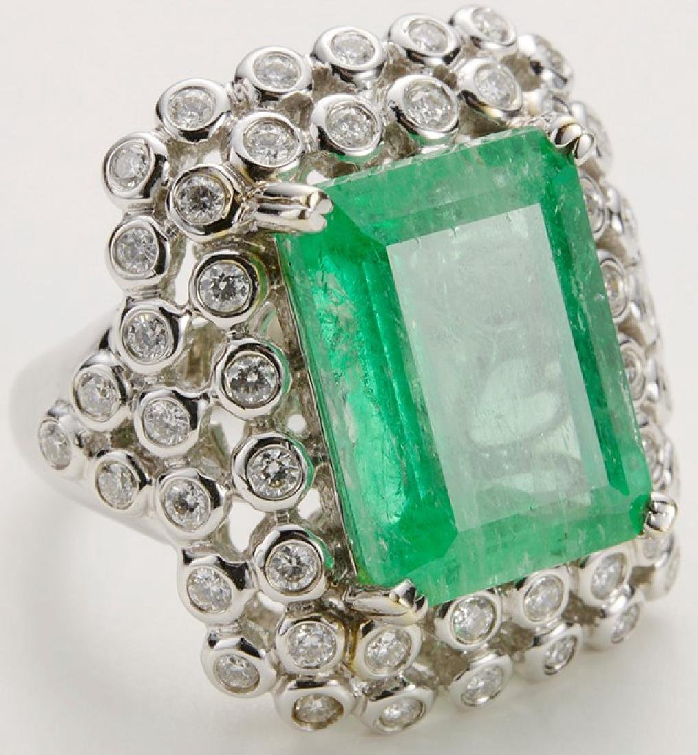 Columbian Emerald 12.66 carats, and 50 round Diamond