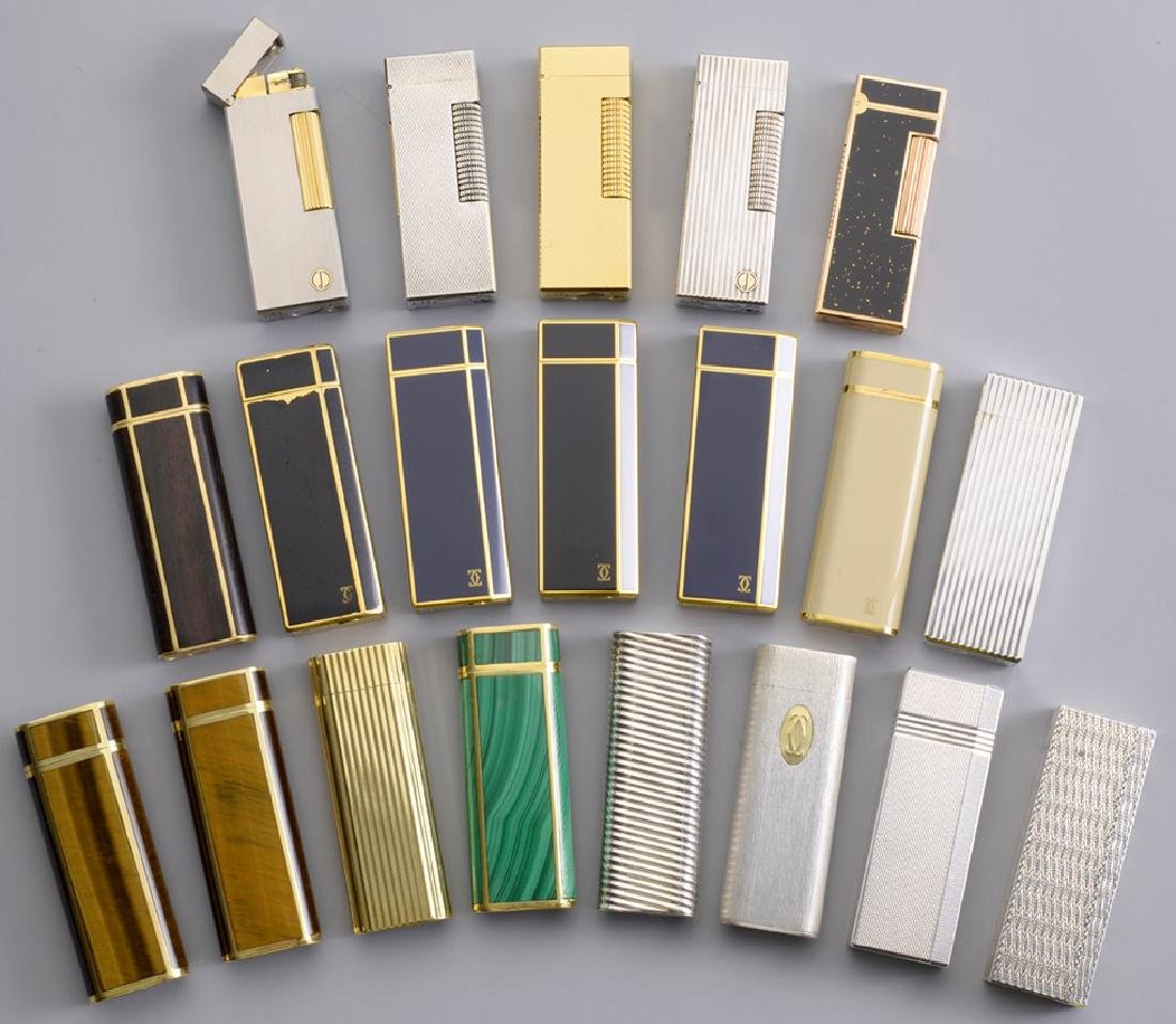 A lot of 21 Vintage Cartier and Dunhill Lighters