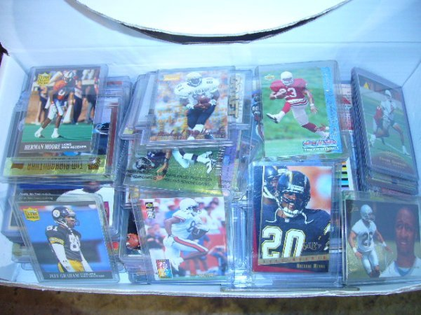 23: (1) Box NFL Cards (Mid 90's) (Most in plastic cases