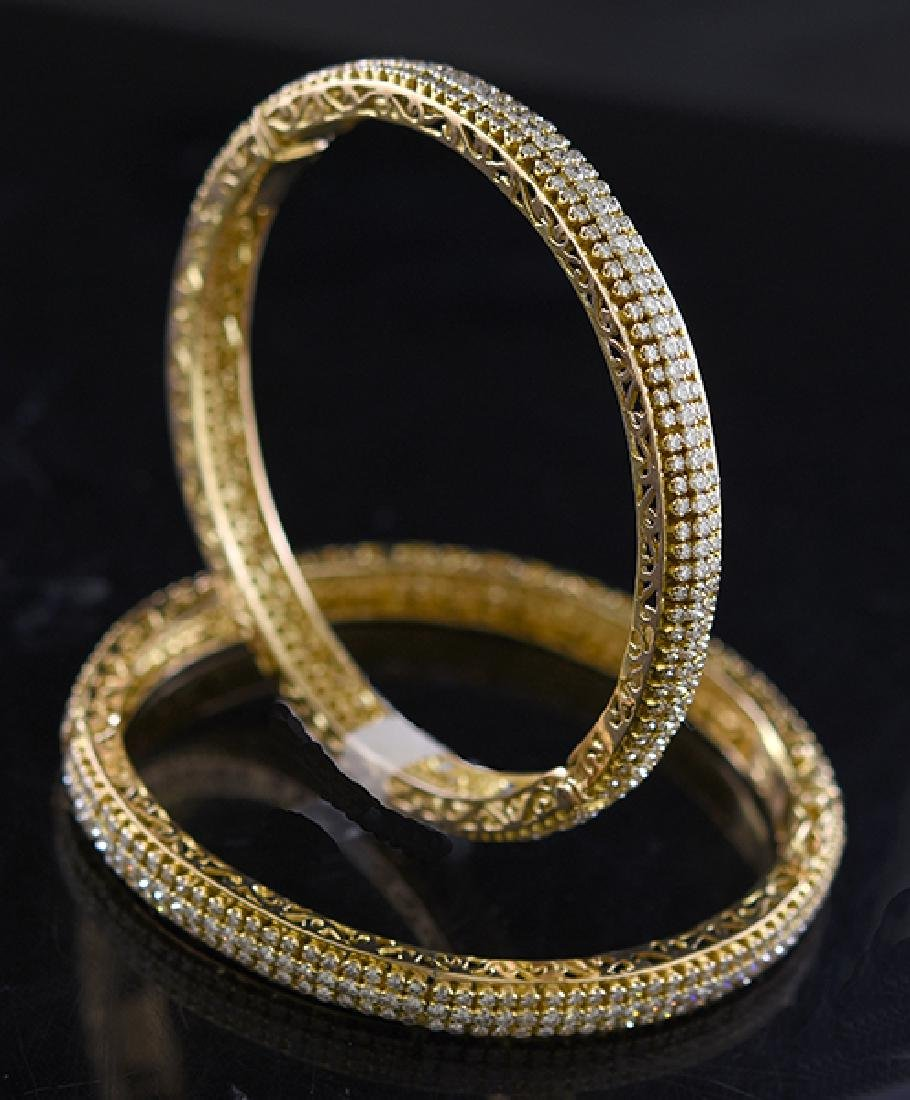 Matched pair of 18k yellow gold and diamond bracelets