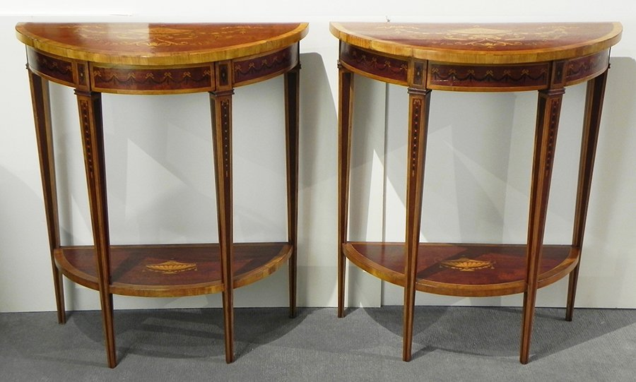 Pair of Continental mahogany demi lune console tables