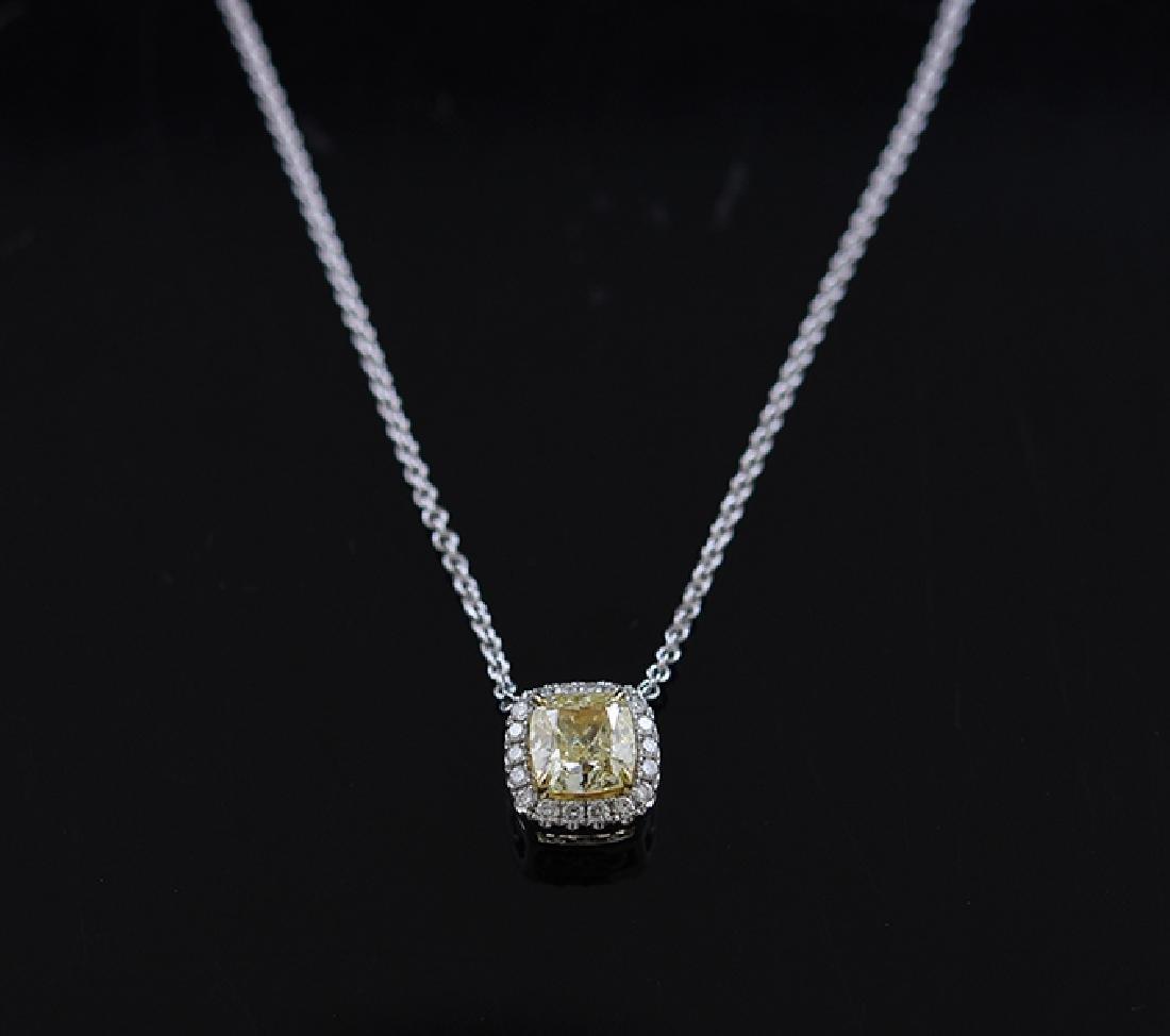Fancy yellow diamond pendant set in 18k white gold