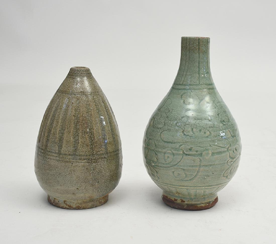 Two early Chinese celadon glazed and carved design