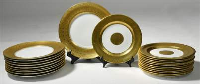 Two sets of gold rimmed porcelain plates