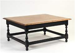 Custom made cherry coffee table on a stretcher base