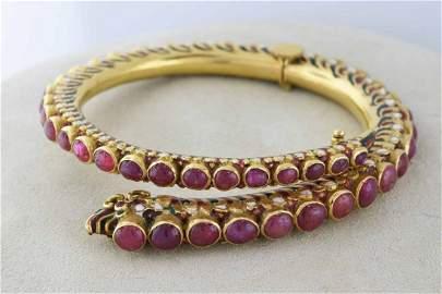 Impressive 18k gold and ruby snake bracelet