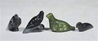 FOUR INUIT CARVED STONE FIGURES