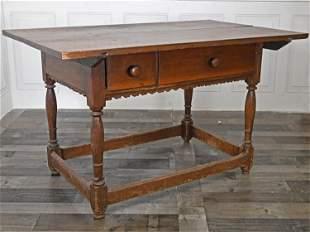 18TH C. PA WALNUT TWO DRAWER TAVERN TABLE.