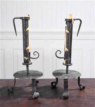 EARLY PAIR OR WROUGHT IRON FOOTED CANDLESTICKS/JACKS.