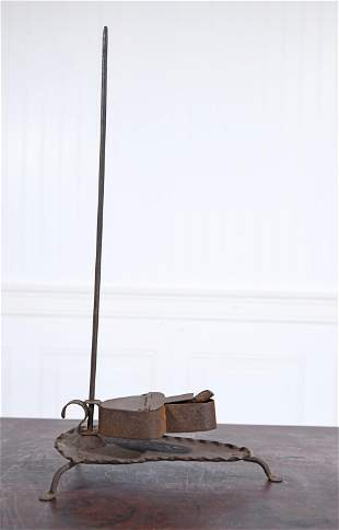 EARLY PRIMITIVE IRON LIGHTING STAND AND BETTY LAMP.