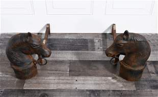 PAIR OF HORSE-HEAD HITCHING POST ANDIRONS.