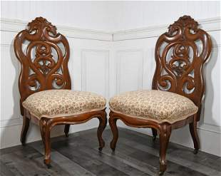 PAIR OF 19TH C. LAMINATED ROSEWOOD SLIPPER CHAIRS.