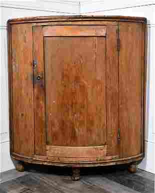 EARLY 19TH C. DEMILUNE FLOOR CABINET.