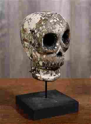 ANTIQUE CARVED AND PAINTED FOLK ART SKULL