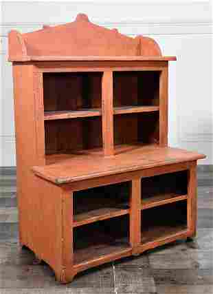 SALMON PAINTED CHILDS SIZE ANTIQUE CUPBOARD.