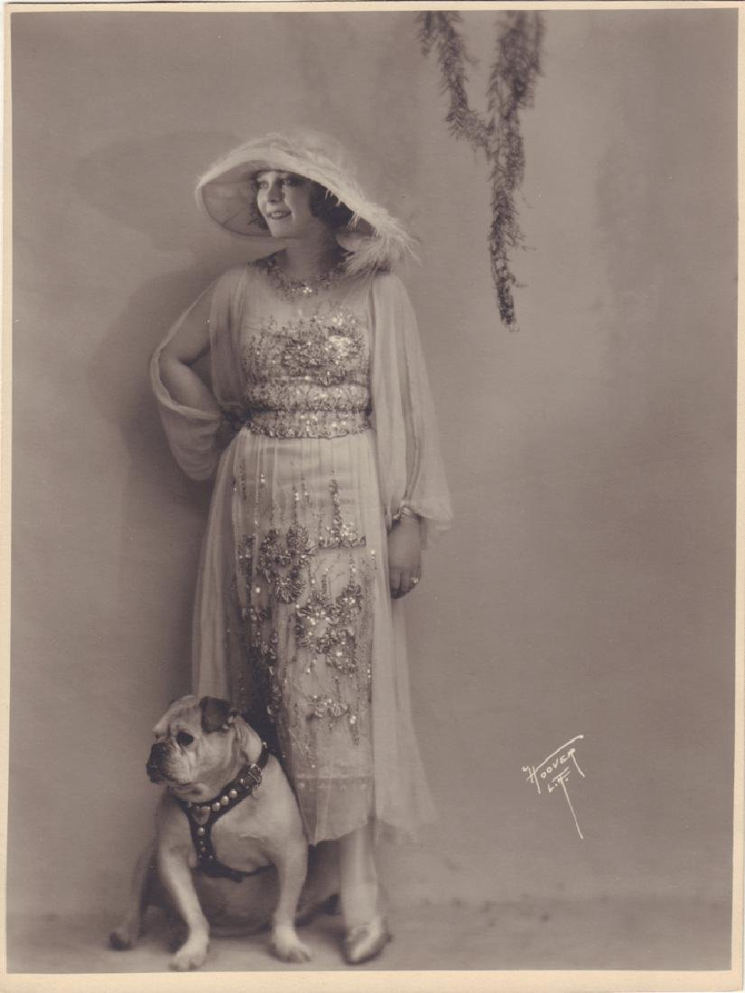 Winifred Westover with a bulldog. Photo of american