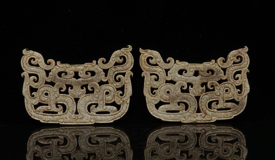 CHINESE PAIR OF ARCHAIC JADE PENDANTS