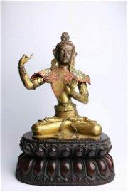 A Chinese Bronze Manjusri Statue