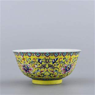 A YELLOW GROUND FAMILLE ROSE FLORAL PORCELAIN BOWL