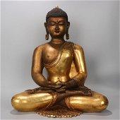 A GILT-BRONZE SEATED BUDDHA STATUE