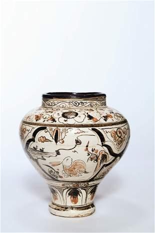 A CERAMIC POTTERY JAR