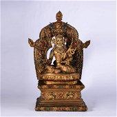 A Gilt Bronze Statue Of Padmasambhava