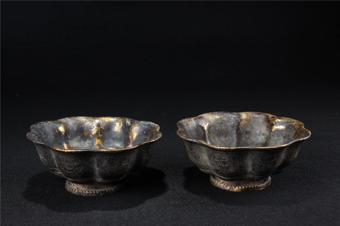 A pair of gilt copper bowl