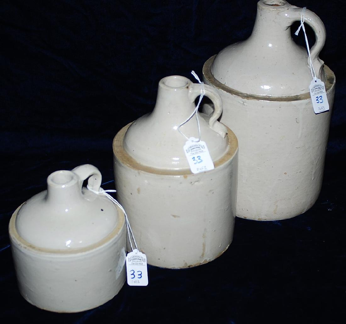 Graduated set of 3 White Glazed Red Wing jugs.
