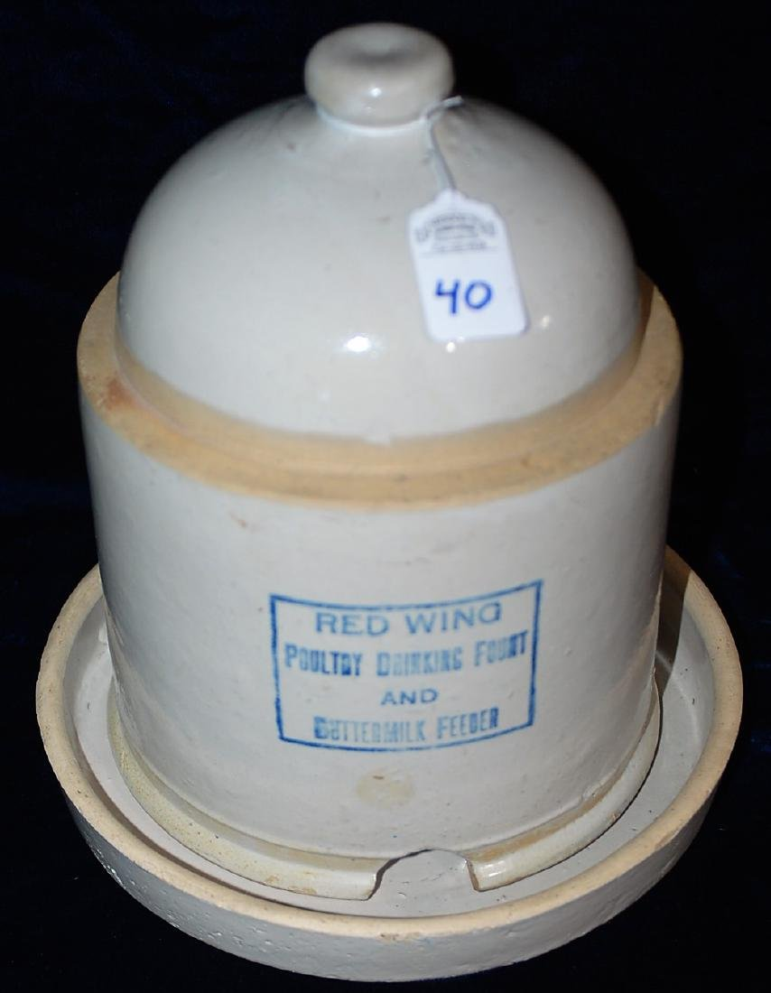 """Chicken waterer. Reads """"RED WING POULTRY DRINKING FOUNT"""