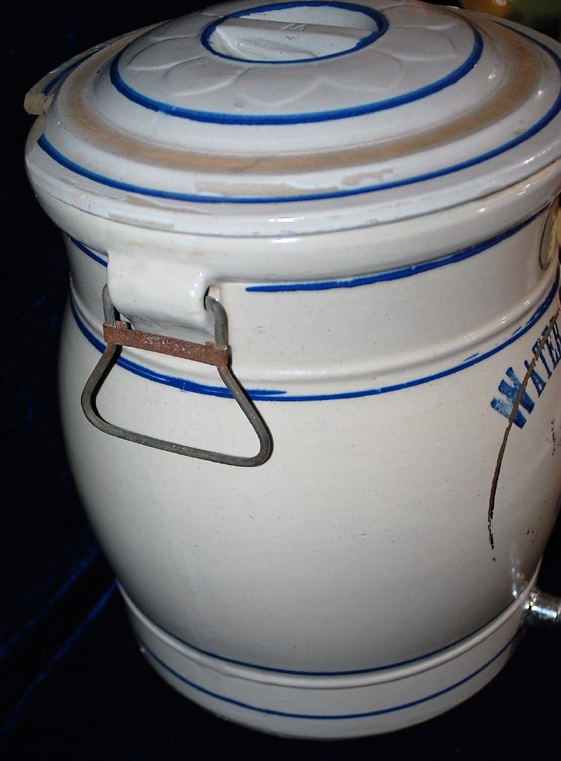 Red Wing five gallon water cooler w/ a blue stenciled 5 - 5