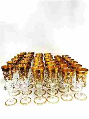 Collection of 36 french glasses with raised gilding