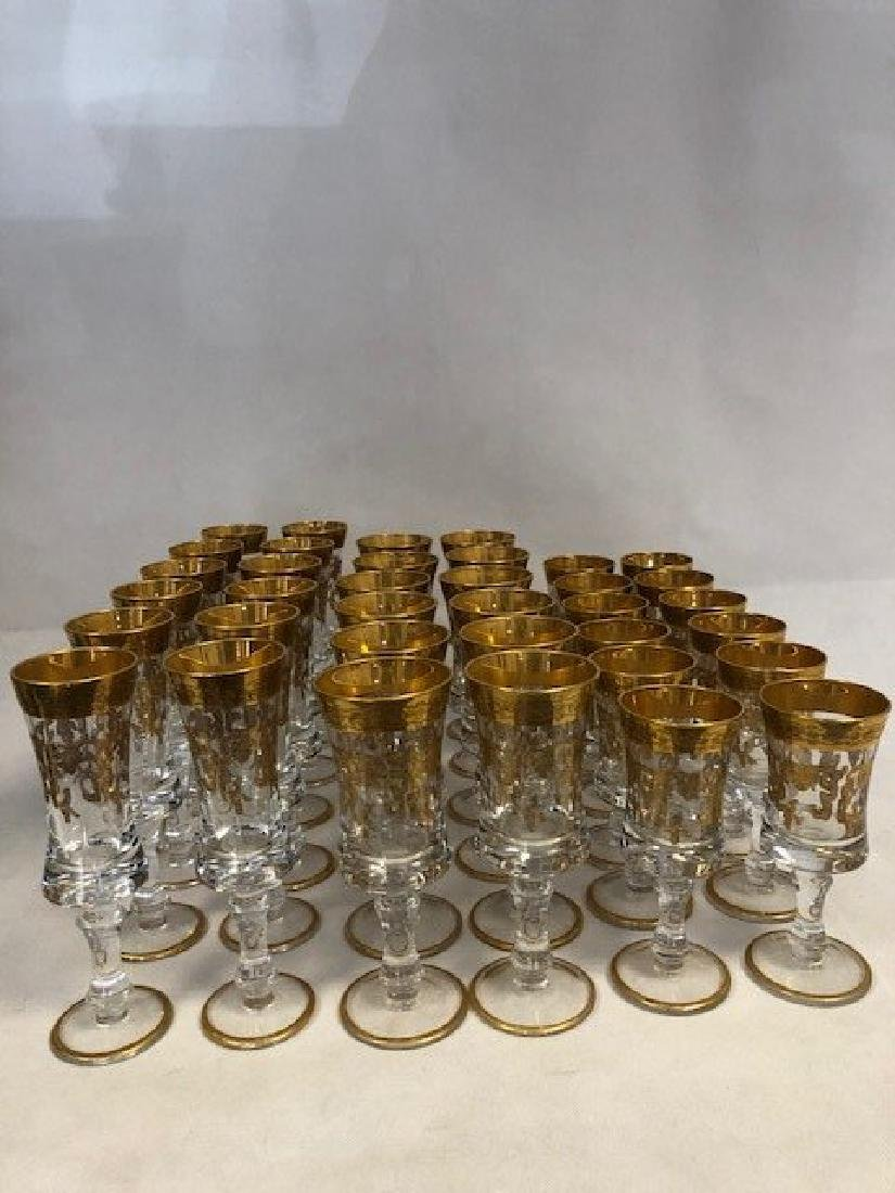 Collection of 36 french glasses with raised gliding