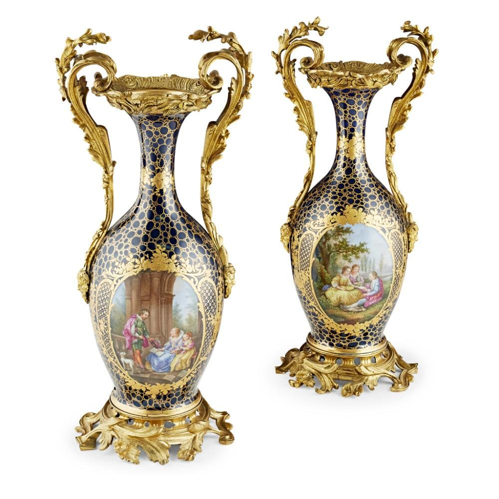 PAIR OF FRENCH GILT BRONZE MOUNTED PORCELAIN VASES,