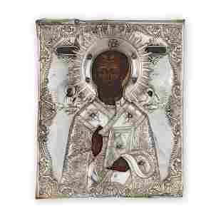 JEWELLED, PARCEL GILT AND SILVER RUSSIAN ICON OF ST.