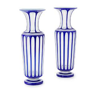 A PAIR OF 19TH CENTURY CASED AND OVERLAID GLASS VASES,