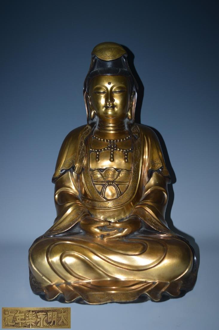 A GILT BRONZE FIGURE OF A SEATED BUDDHA