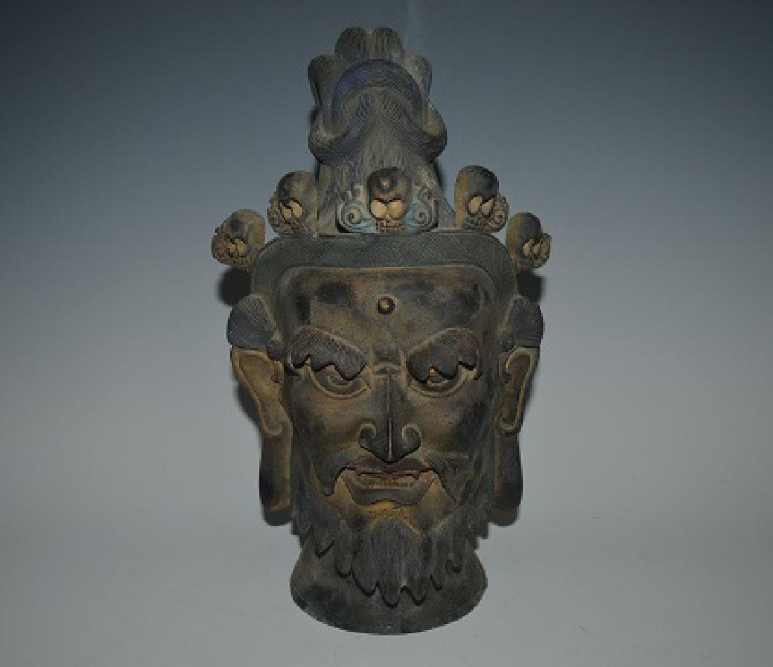 A CHINESE BRONZE HEAD