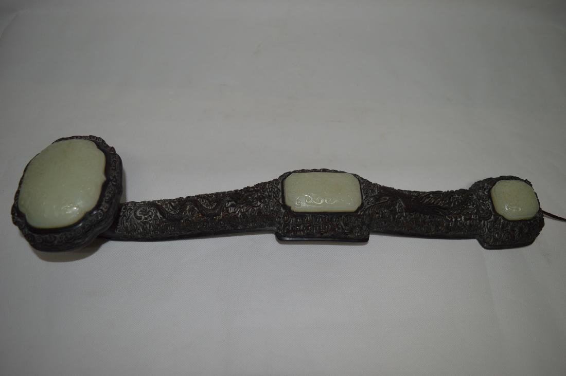 A CARVED WOOD AND WHITE JADE RUYI