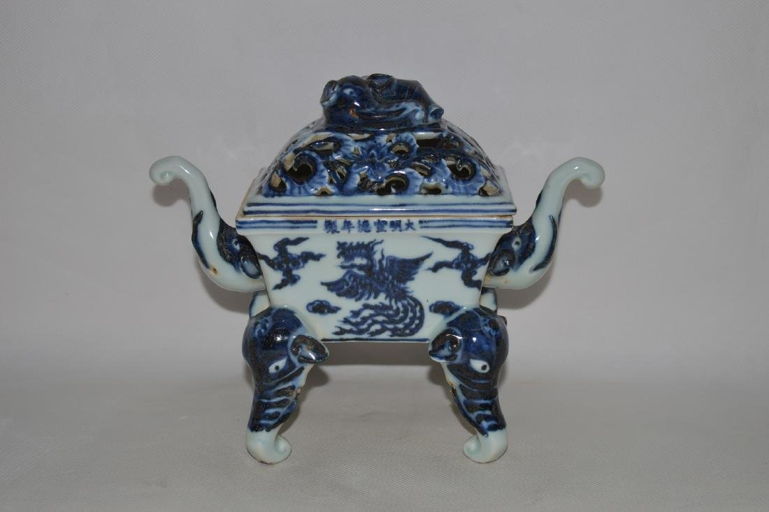 """A BLUE AND WHITE """"ELEPHANT TRUNK"""" HANDLE CENSER AND"""