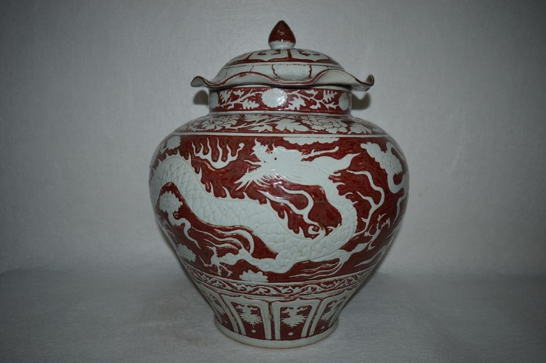 """A RED GLAZED """"DOUBLE WHITE DRAGON """" JAR WITH COVER"""
