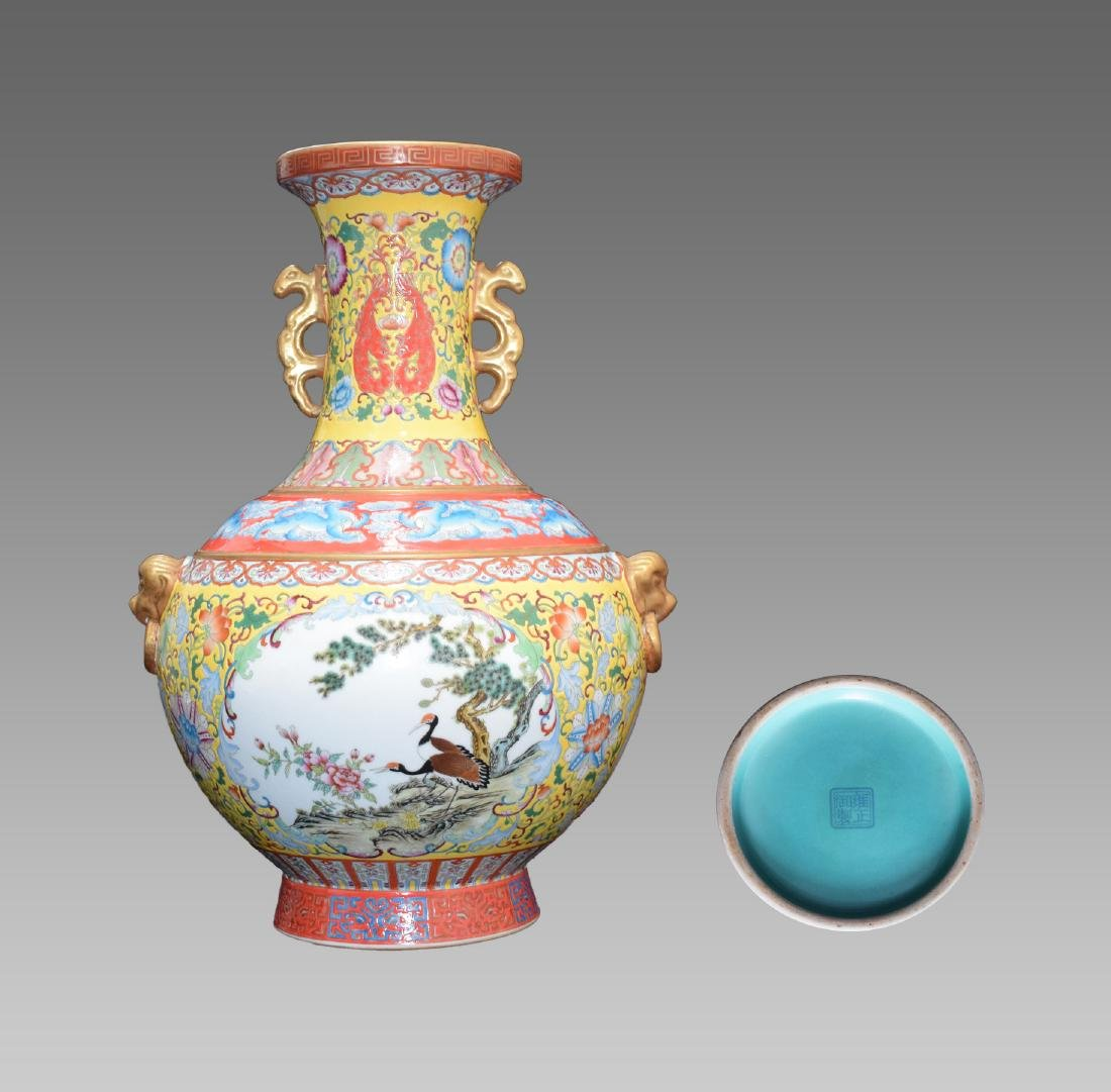 A FAMILLE ROSE YELLOW GROUND VASE